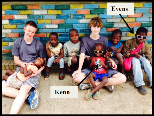 Noah on ground with kids